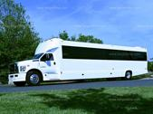 a white ford party bus