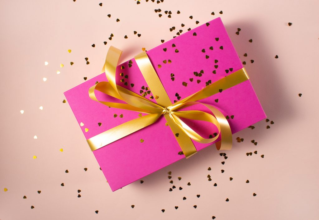 a pink and gold party favour