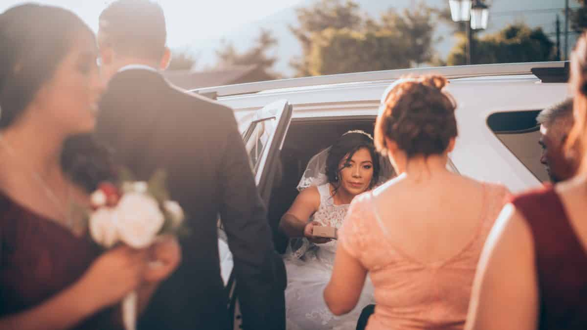 a bride getting out of a limousine